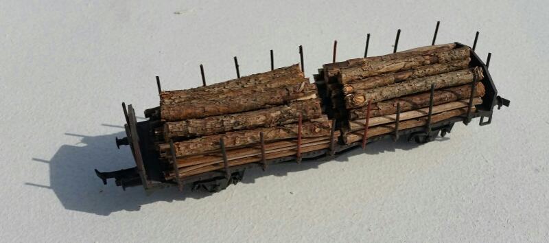 Grenar som timmerlast på O-vagn